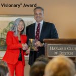 Dr. Joanny receiving award for Healing Visionary